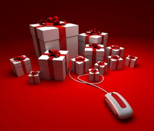 presents on red background with computer mouse holiday presents