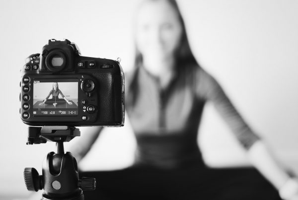 Blogger recording a video with a camera influencer marketing
