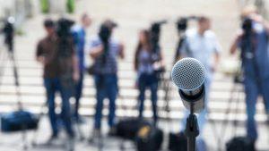 evolve & co public relations public speech microphone press media publicity people outside