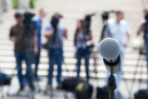 evolve & co public relations public speech microphone press media publicity people outside