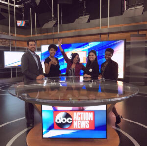 Evolve & Co team standing behind the ABC Action News Tampa, Florida news desk