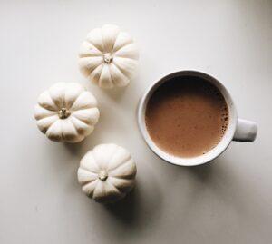 Chai latte and white pumpkins