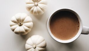 Chai latte and white pumpkins