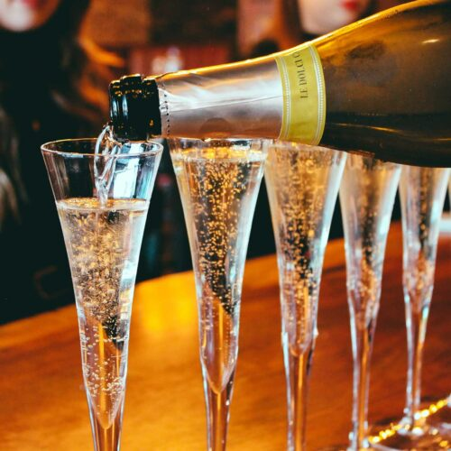 champagne pour at Flute & Dram on Beach Drive in downtown St. Petersburg