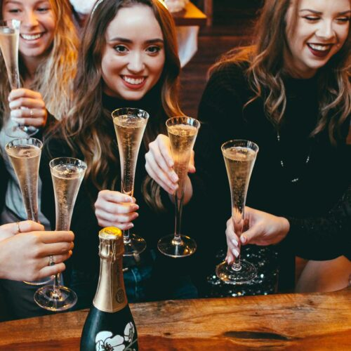 champagne cheers at Flute & Dram on Beach Drive in downtown St. Petersburg