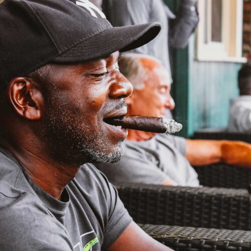 man smoking at Ruby's Elixir and Central Cigars in downtown St. Petersburg, FL
