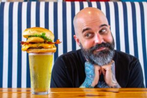 Jesse Kage looking at the Kage burger at the Boulevard Burgers and Taphouse