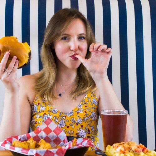 Woman enjoying burger at the Boulevard Burgers and Taphouse