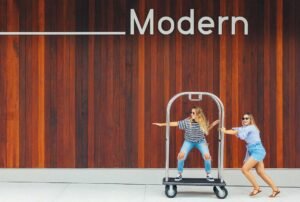 Women on luggage cart at The Sarasota Modern