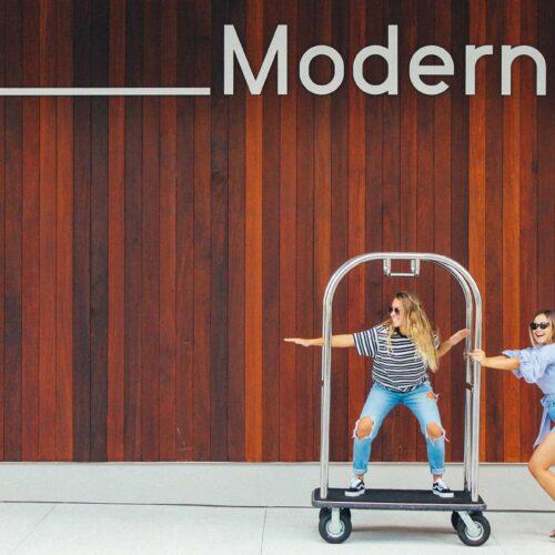 Women on luggage cart at The Sarasota Modern